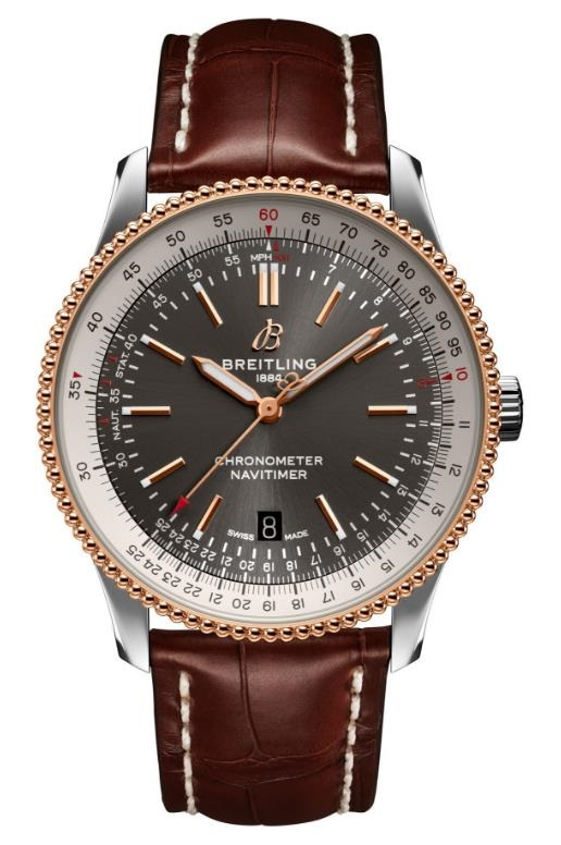 The smoky-grey dials fake watches have brown leather straps.