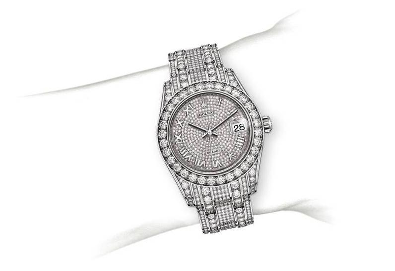 The 18ct white gold copy watches are paved with diamonds.