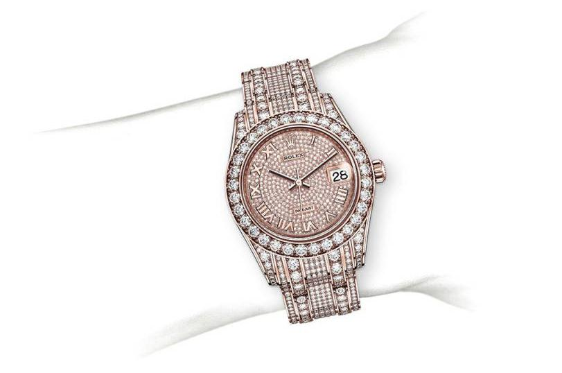 The 18ct everose gold fake watches are paved with diamonds.